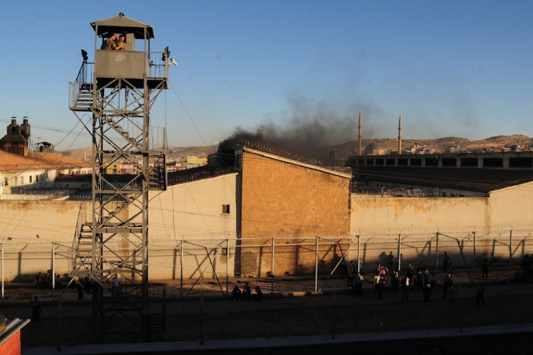 <p>Smoke rises from Sanliurfa city prison in June, 2012, in Sanliurfa, Turkey. The prison saw a riot and two fires in a month, just one of Turkey's many prisons facing what a new report called