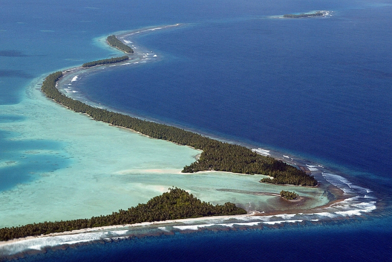 <p>King tides in the South Pacific swallow the coastline of Funafuti Atoll, 19 February 2004, home to nearly half of Tuvalu's entire population of 11,500.</p>