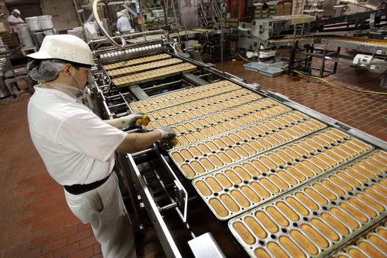 <p>In better times before the bankruptcy, a worker checks Hostess Twinkies as move through production in their trays prior to cream injection at the Interstate Bakeries Corporation facility April 20, 2005 in Schiller Park, Illinois.</p>