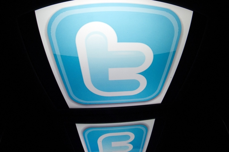 <p>The 'Twitter' logo is seen on a tablet screen on December 4, 2012 in Paris.</p>