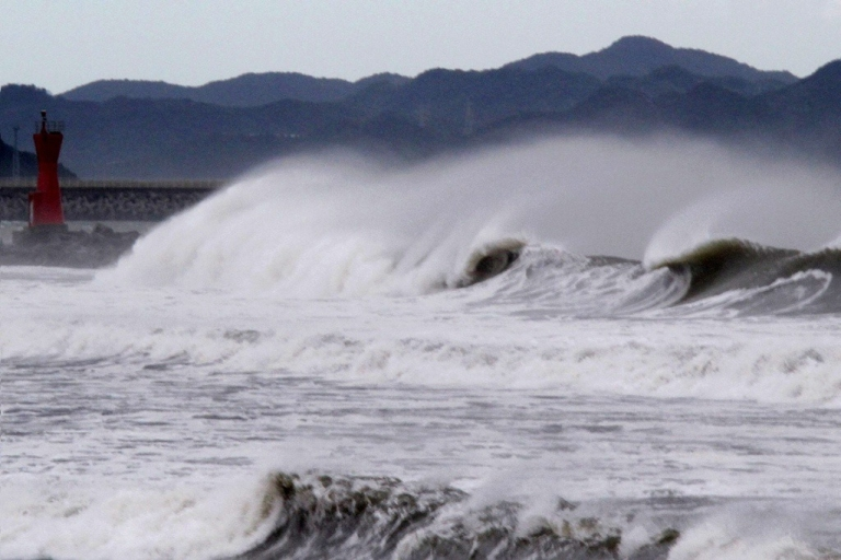 <p>High waves batter a breakwater at Komatsu beach in the city of Tokushima, Tokushima prefecture, in western Japan on September 21, 2011.</p>