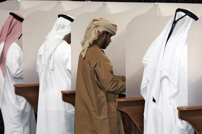 <p>Emirati voters fill their ballots at a polling station in Abu Dhabi before voting in the country's first elections, on December 16, 2006. The United Arab Emirates began its first elections with a limited number of voters choosing half the members of an advisory council, a small step in a tightly controlled reform process.</p>