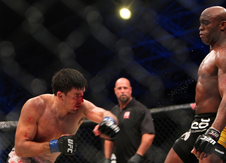 <p>Brazil's Anderson Silva (R) is attacked by his compatriot Demian Maia during their Ultimate Fighting Championship (UFC) 112 middleweight bout in Abu Dhabi on April 10, 2010. Silva won the fight.</p>