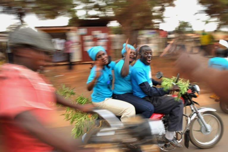 <p>A supporter of Ugandan opposition leader Kizza Besigye cheers as the presidential candidate rides past in Kampala, Uganda on February 16, 2011, the last day of campaigning for presidential elections. Veteran President Yoweri Museveni predicted a landslide victory in polls this week, dismissing Besigye's assertions that Uganda was ripe for an Egypt-style uprising.</p>