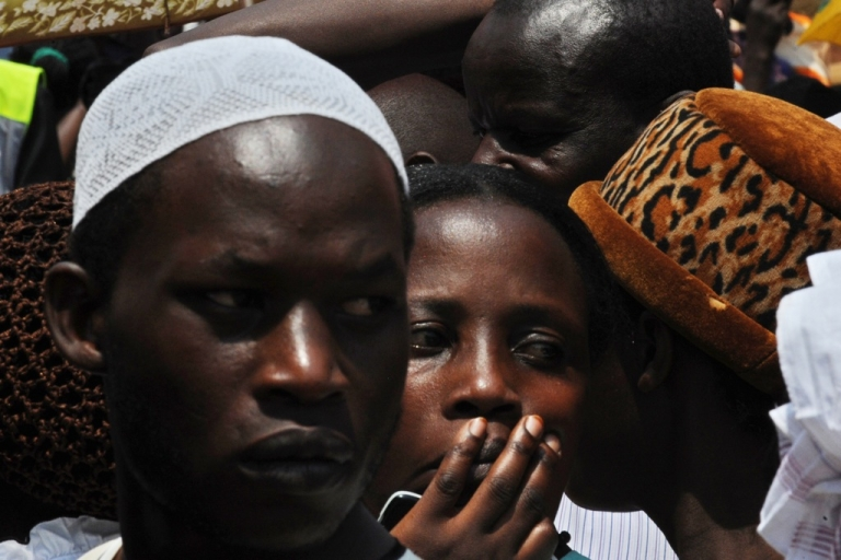 <p>Voters wait in line at a polling station in the Ugandan capital Kampala on Feb. 18, 2011.</p>