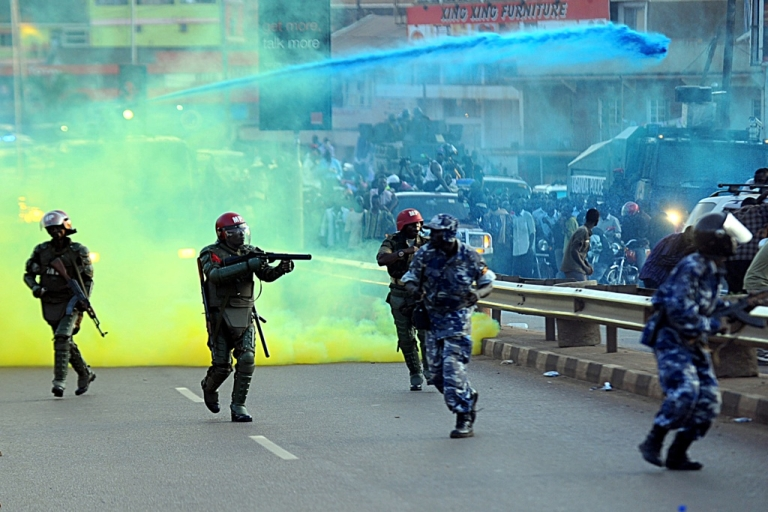 <p>Ugandan anti-riot forces fire tear gas to disperse supporters of Ugandan opposition leader Kizza Besigye rallying to welcome the opposition leader back to Kampala from Nairobi on May 12, 2011. Besigye's supporters overshadowed the inauguration of Ugandan President Yoweri Museveni to a fourth term. Museveni vowed to stamp out 'disrupting schemes' on May 12.</p>