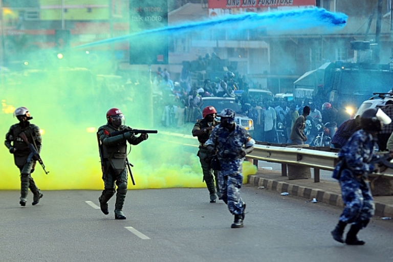 <p>Ugandan anti-riot personnel fire tear gas to disperse supporters of Ugandan opposition leader Kizza Besigye on May 12, 2011. Ugandan President Yoweri Museveni denounced journalists as