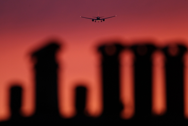 <p>An airplane comes in to land at Heathrow airport at sunset on April 2, 2011 in London, England.</p>
