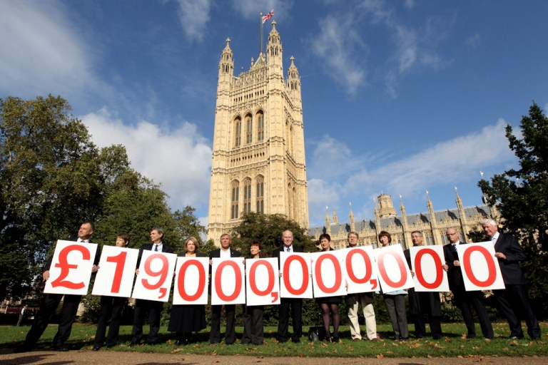 <p>Thirteen leaders of the United Kingdom's public sector unions hold up placards displaying the figure 19 billion pounds ($26.5 billion), which is the tax revenue avoided by U.K. banks, in front of Parliament on Oct. 19, 2010 in London, England.</p>