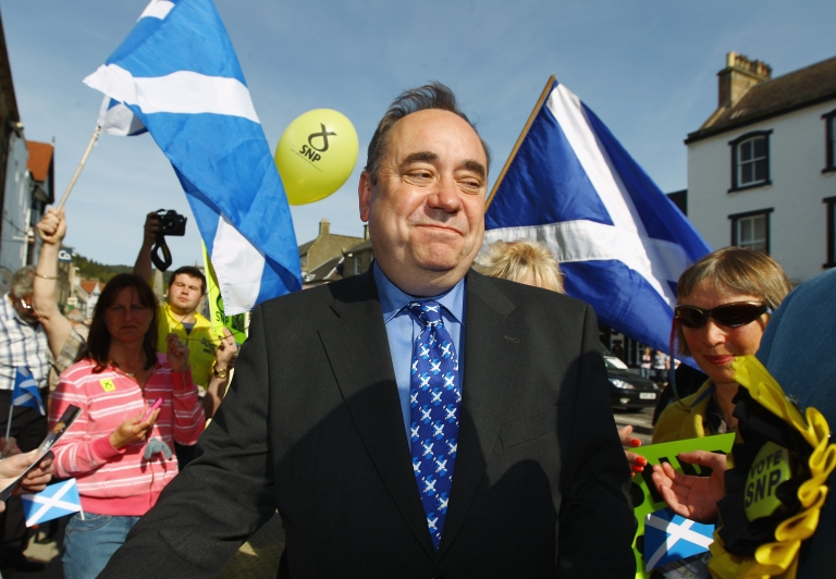 <p>Scottish National Party leader Alex Salmond during the campaign for Scottish parliament on May 4, 2011 in Peebles, Scotland. Behind him, supporters wave the Scottish flag.</p>