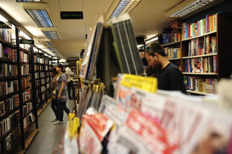 <p>People browse literature at a bookstore on August 3, 2011.</p>