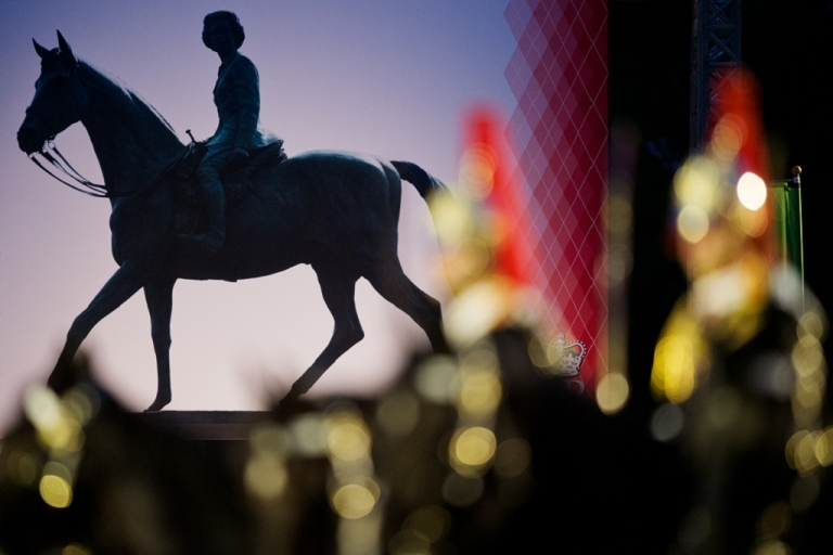 <p>Soldiers ride in front of a picture of Queen Elizabeth II during the Diamond Jubilee Pageant in Windsor, England on May 10 2012. Celebrating the 60 year reign of Queen ELizabeth II, 1,200 performers and 550 horses take part in the show in the private grounds of Windsor Castle.</p>