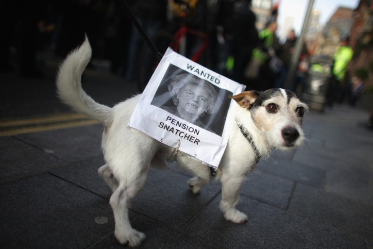 <p>Pet dog Milo walks with a sign during a march for the public sector strike on November 30, 2011 in Liverpool, UK. More than 2 million public sector workers are staging a nationwide strike over cuts to their public sector pensions.</p>