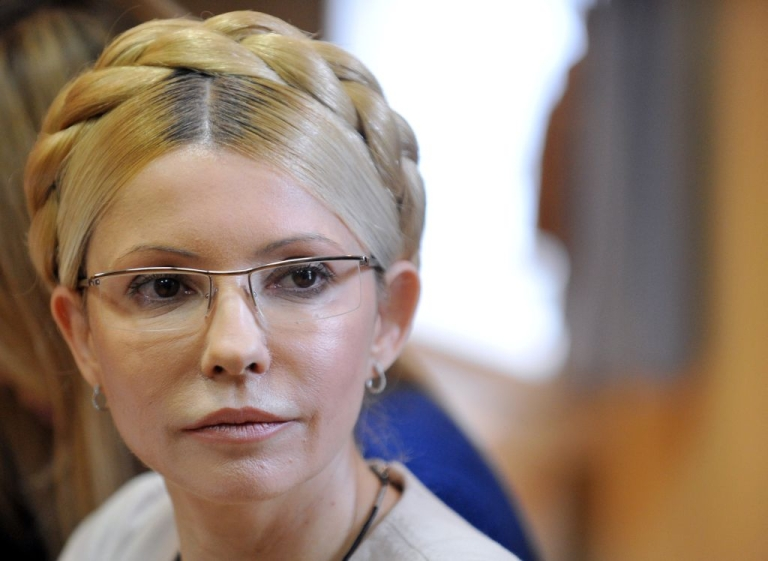 <p>Ukraine's former Prime Minister Yulia Tymoshenko listens as the verdict on her case is read out on Oct. 11, 2011. Tymoshenko was sentenced to seven years in jail for abusing her powers in a 2009 gas deal with Russia, a verdict that has harmed ties with the European Union and other Western powers.</p>