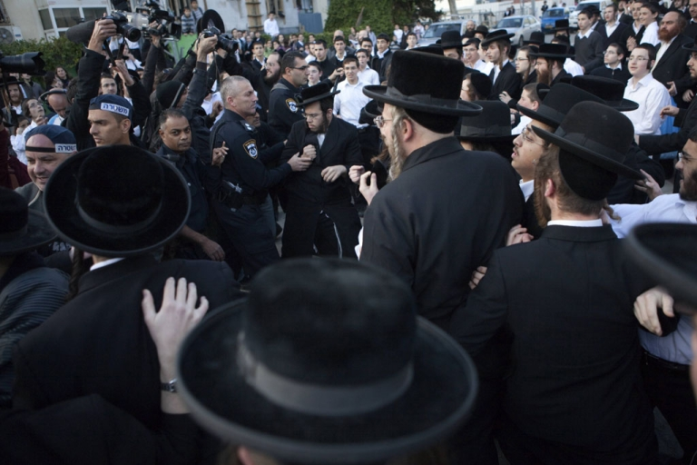 <p>Israelis policemen disperse ultra-Orthodox Jewish protesters in the central town of Beit Shemesh, near Jerusalem, on Dec. 26, 2011. Extra Israeli police patrolled the streets of Beit Shemesh after a campaign by ultra-Orthodox Jews to segregate men and women erupted into violence.</p>