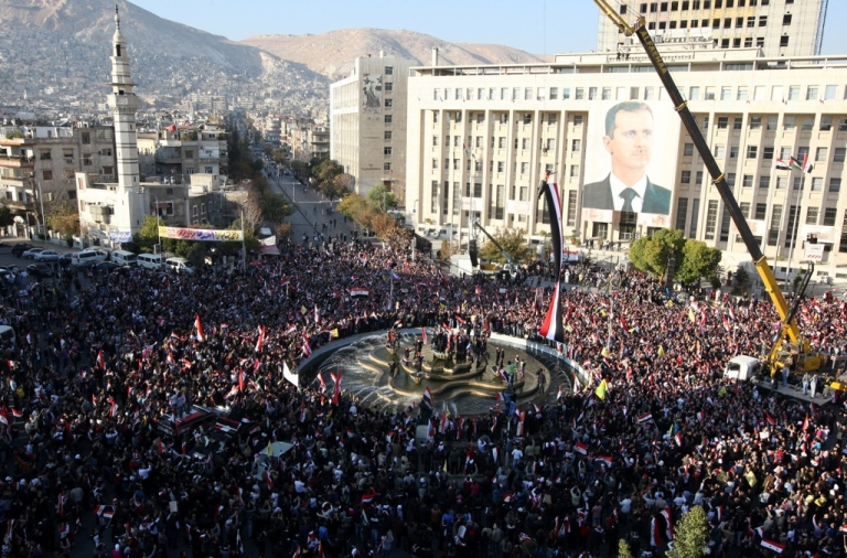 <p>Syrian pro-regime supporters take part in a rally in Damascus on December 2, 2011. Europe and the United States tightened economic sanctions on Syria, ramping up international pressure as the UN said more than 4,000 people had died in a crackdown on dissidents.</p>