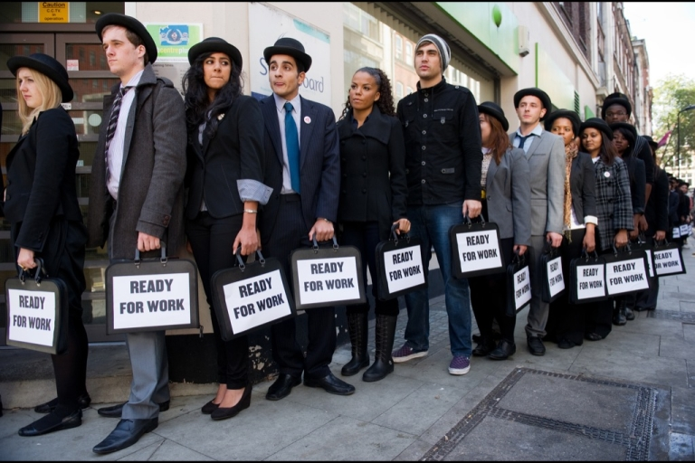 <p>Unemployed young people stand in line outside a job centre in central London during a photocall for the Battlefront Campaign, raising awareness of the large number of young people who are currently unemployed in the UK.</p>