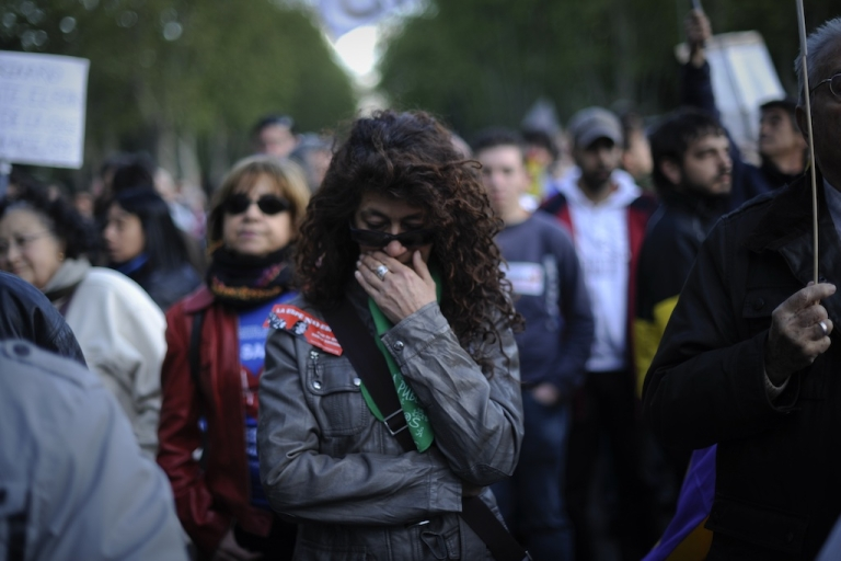 <p>Protesters attend a rally against financial cuts in health and education in Madrid on April 15, 2012. Spain has nearly 50 percent unemployment for workers under 30.</p>