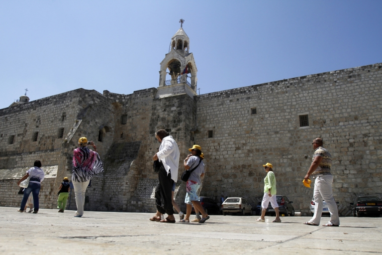 <p>Christian pilgrims visit the Church of Nativity, the traditional birthplace of Jesus Christ, in the biblical Palestinian town of Bethlehem on June 28, 2012. Less than a year after winning membership at UNESCO, the Palestinians won a bid to place the Church of the Nativity on the World Heritage sites list.</p>
