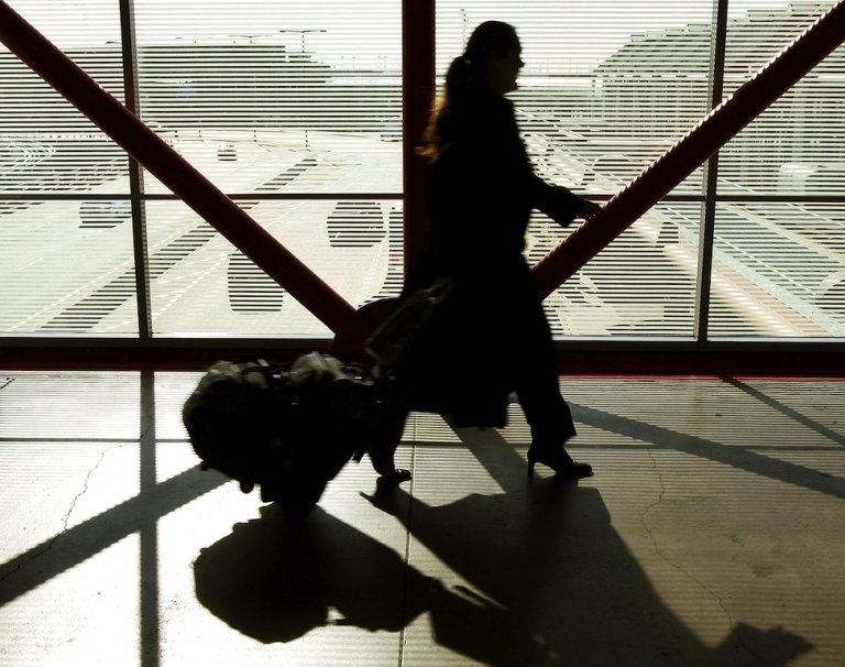 <p>A Chicago woman has settled $105,000 parking fine after her car was abandoned at O'Hare International Airport in 2009. A pedestrian overpass at O'Hare International Airport on February 1, 2006 in Chicago.</p>