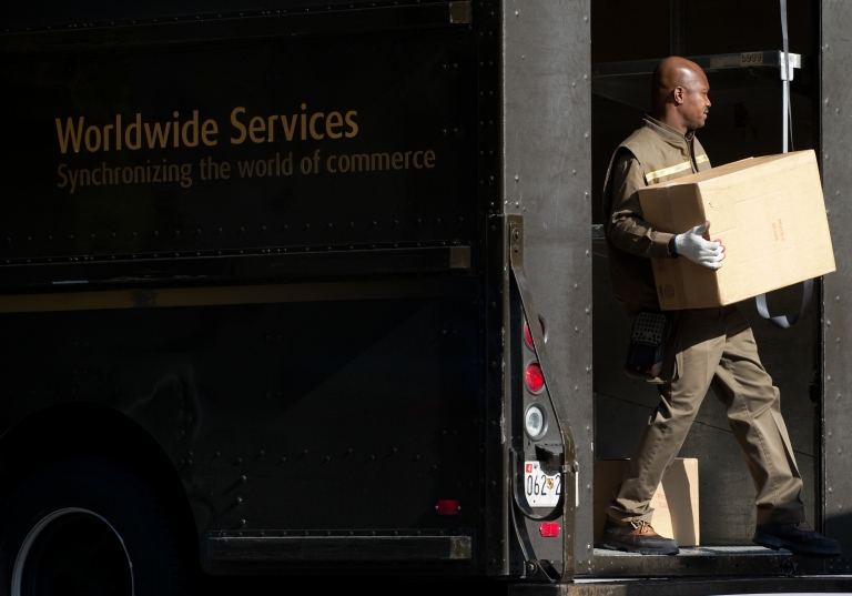 <p>A United Parcel Service delivery man unloads boxes from his truck outside a business in Washington, DC, on Nov. 5, 2010.</p>