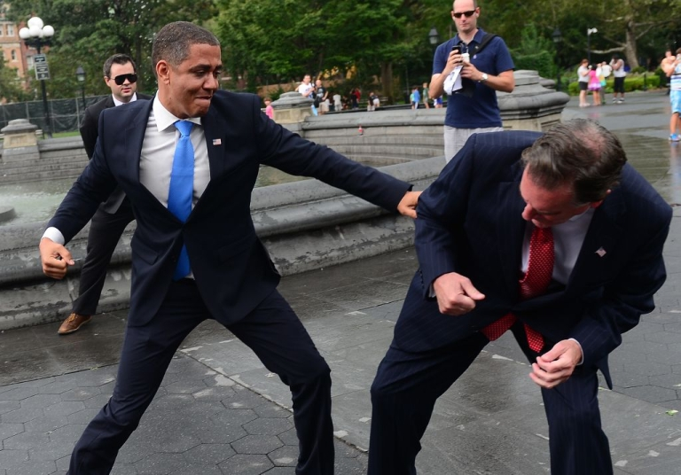 <p>US Presidential candidate Mitt Romney impersonator Mike Cote (R) 'fights' with US President Barack Obama impersonator Reggie Brown during an Obama vs Romney 'showdown' in Washington Square Park in New York on September 05, 2012. (EMMANUEL DUNAND/AFP/GettyImages)</p>