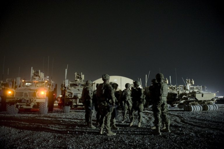 <p>Infantry men  attend a briefing prior to embarking on a night patrol from Lindsey foward operating base on Sept. 15, 2012 in Kandahar province, Afghanistan. Two NATO soldiers were shot dead that day by a man believed to be a member of a Afghan police force in southern Afghanistan, the US-led military said.</p>