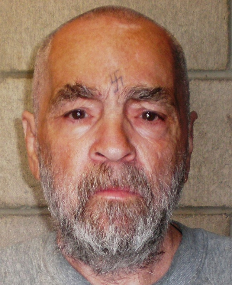 <p>Charles Manson poses for a photo on March 18, 2009 at Corcoran State Prison, California, where he is serving a life sentence for conspiring to murder seven people during the