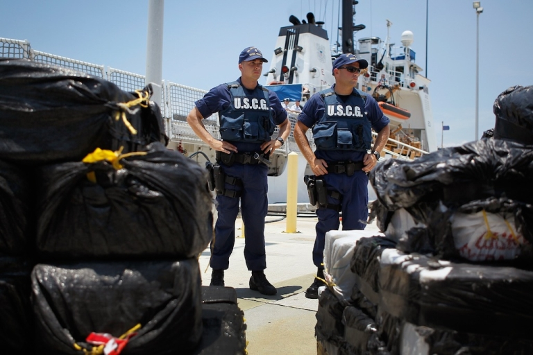 <p>Coast Guard members next to approximately 3,800 pounds of cocaine at the Miami Beach Coast Guard Station on June 29, 2012 in Miami Beach, Florida.</p>