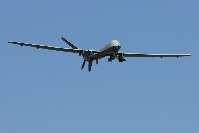 <p>An MQ-9 Reaper flies by on a training mission Aug. 8, 2007 at Creech Air Force Base in Indian Springs, Nevada.</p>