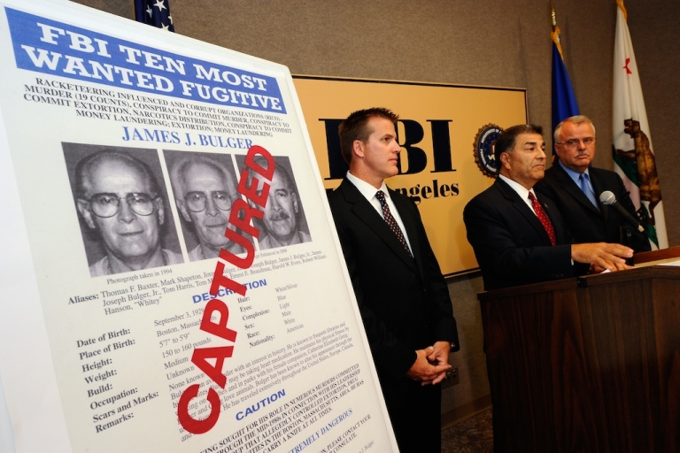 <p>Members of the FBI and LAPD speak during a news conference to discuss the arrest of Boston crime boss James
