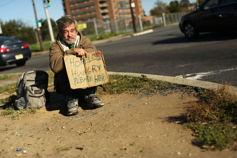 <p>A homeless man named Bob waits for donations from passing motorists on October 11, 2012 in Camden, New Jersey. According to the U.S. Census Bureau, Camden, New Jersey is now the most impoverished city in the United States with nearly 32,000 of Camden's residents living below the poverty line.</p>