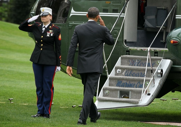 <p>President Barack Obama salutes a US Marine on the White House lawn, on March 30, 2012. The US president is the commander-in-chief of the American armed forces.</p>