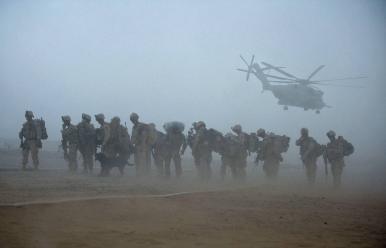 <p>U.S. Marines from the 2nd Battalion, 8th Marine Regiment of the 2nd Marine Expeditionary Brigade wait for helicopter transport in Helmand province, southern Afghanistan, on August 9, 2011.</p>