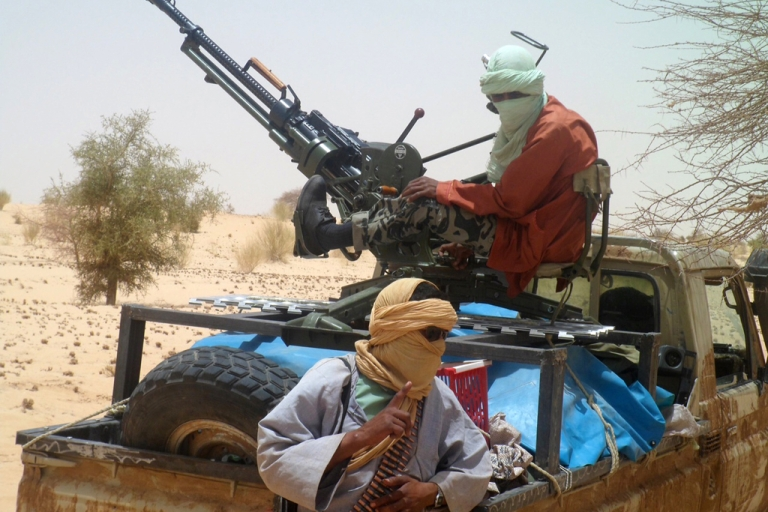 <p>Islamist rebels of Ansar Dine are pictured on April 24, 2012 near Timbuktu, rebel-held northern Mali, during the release of a Swiss hostage. According to The Washington Post, the US military has expanded its surveillance network in Africa to keep track of militants and terrorists, using small planes equipped with sensors.</p>