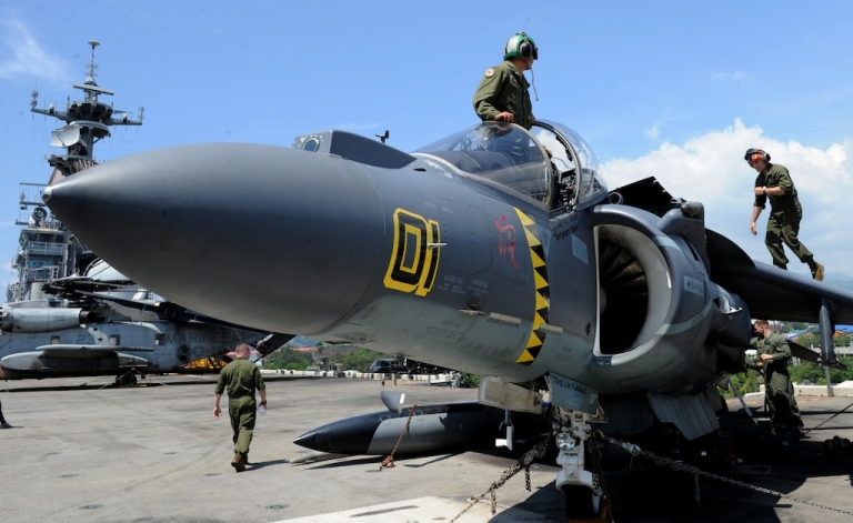 <p>Aircraft mechanics repair a harrier jet on deck the USS Bonhomme Richard after the formal opening of the annual Philippine-US Amphibious Landing Exercises program at the former US naval base of Subic on Oct. 8, 2012.</p>