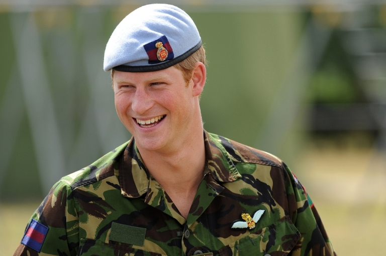 <p>Britain's Prince Harry laughs as he speaks with RAF personnel during a visit to an RAF base in Suffolk, eastern England in July 2010.</p>