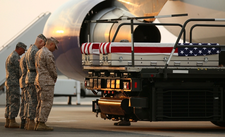 <p>Military chaplains pay respects to two marines at Dover Air Force Base. The base dumped the remains of 274 US troops in a landfill between 2004-08.</p>