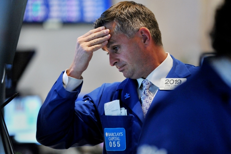 <p>A trader reacts to the market downfall on the New York Stock Exchange, August10, 2011. US stocks plummeted, more than wiping out the gains of Tuesday's rebound. The Dow was down 519.83 points (4.62 percent) to 10,719.94 at closing, compared to its 430-point gain on Tuesday.</p>