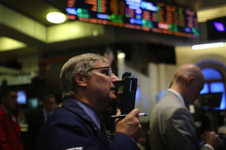 <p>Traders work on the floor of the New York Stock Exchange on June 6, 2012.</p>