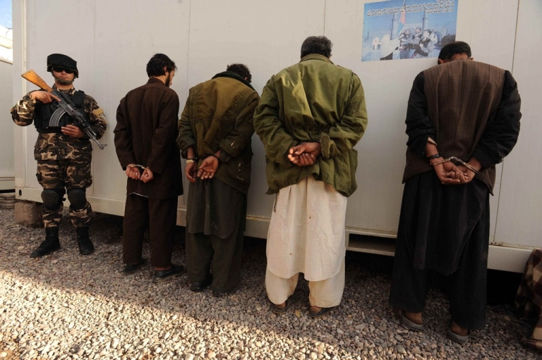 <p>Captured Taliban fighters are presented to the media in Herat, Afghanistan on November 30, 2011. Herat security forces captured four insurgents from Herat, officials said in a statement.</p>