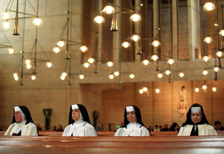 <p>Nuns wait for Christmas mass at The Cathedral of Our Lady of the Angels in Los Angeles, California on Dec. 25 2010.</p>