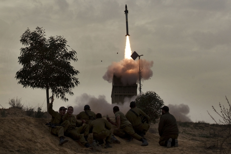 <p>Israeli soldiers watch as a missile is launched from the Iron Dome defense system. A US war simulation of a possible scenario where Israel launched pre-emptive strikes against Iran's nuclear facilities would likely draw America into the conflict and cost hundreds of lives, a report said on March 20, 2012.</p>