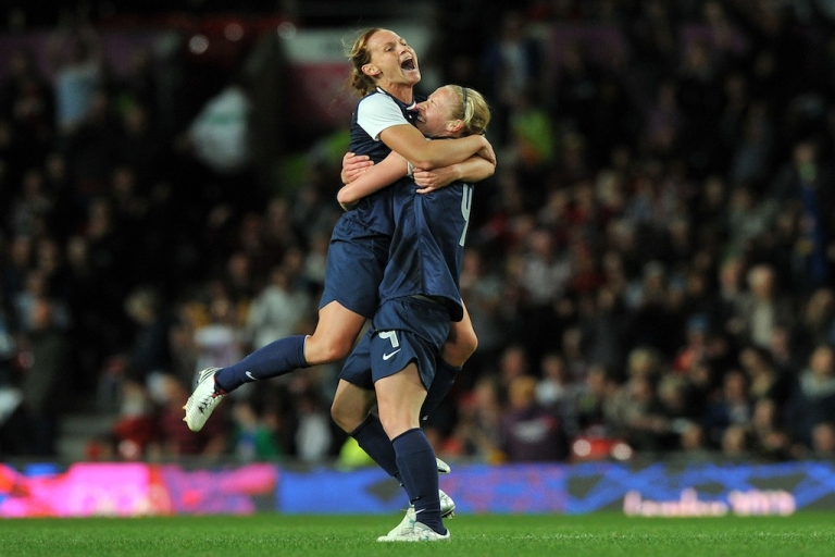 <p>US soccer players celebrate the winning goal in the London 2012 Olympic women's football semi final match between USA and Canada at Old Trafford in Manchester, England, on August 6, 2012. USA won 4-3.</p>