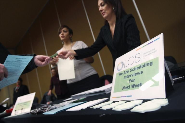 <p>Job applicants meet potential employers at a job fair in Denver.</p>