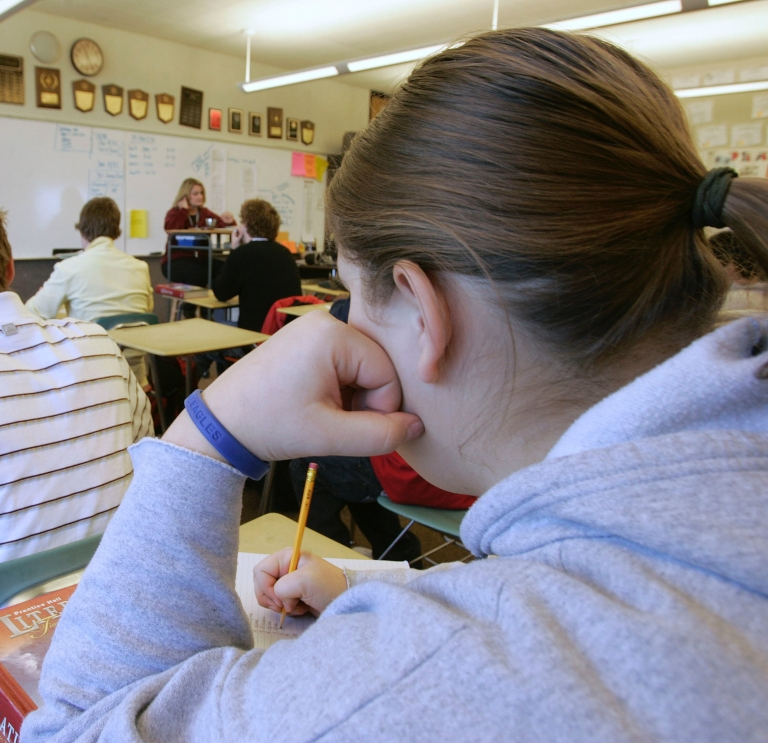 <p>A student takes notes in English class at Skyline High School in Salt Lake City, Utah, on Jan. 4, 2004.</p>