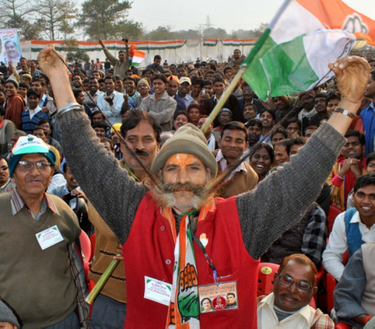 <p>A Congress party supporter poses for the camera during an state assembly election campaign rally by party president Sonia Gandhi in Allahabad on February 8, 2012. India's most populous state went to the polls in a contest pitting the scion of the Gandhi political dynasty against the ruling party of local low-caste leader Mayawati.</p>