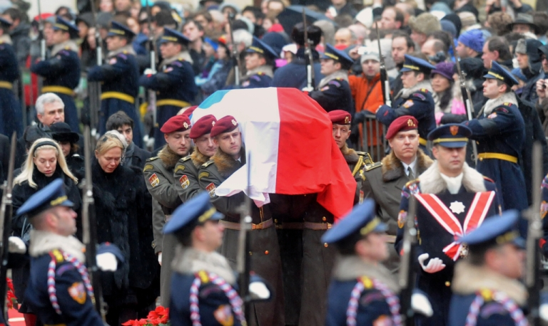 <p>Draped in the Czech flag, Vaclav Havel's coffin is carried into Prague Castle on December 21, 2011, followed by his widow Dagmar, his daughter Nina, and a crowd of an estimated 10,000 people.</p>