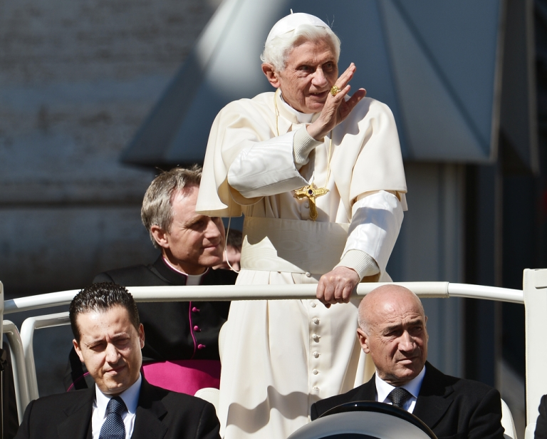 <p>Paolo Gabriele (Bottom L), the pope's butler, sits in the popemobile next to Pope Benedict XVI as they arrive in St. Petr's square on April 18, 2012 for the pope's weekly general audience. Vatican police arrested the pope's butler on May 25, 2012, on allegations of having leaked confidential documents and letters from the pontiff's private study to the newspapers, Italian media reported.</p>