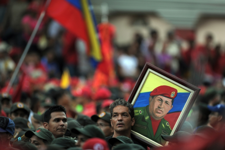 <p>Supporters hold a portrait of Venezuelan President Hugo Chavez during the commemoration of the ninth anniversary of the failed coup against him.</p>